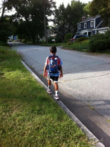 My big guy walking to the bus stop on his first day of kindergarten.