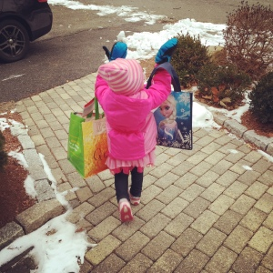 The bag of snowpants and boots were almost as big as her -- no problem.