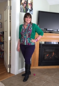 Purple jeans, colorful top, green cardigan, black boots, vintage crystal necklace.